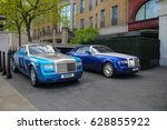Small photo of London, England - 10.04.17: two Rolls-Royce luxury cars are parked outside the Wellesley hotel in Knightsbridge district. Phantom Drophead Coupe is one of the most expensive models of Rolls-Royce.