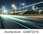 modern urban traffic at night | Shutterstock . vector #628872476