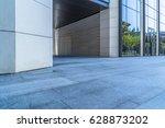 empty pavement and modern... | Shutterstock . vector #628873202