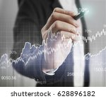businessman drawing graphics a... | Shutterstock . vector #628896182