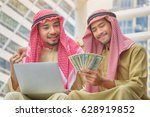 two arab businessmen rejoice in ... | Shutterstock . vector #628919852