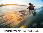 surfer rides the ocean wave at... | Shutterstock . vector #628938266