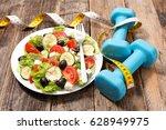 diet food  fresh salad | Shutterstock . vector #628949975