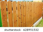 Close Up On Wooden Fence Door...