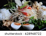somtum or papaya  salad | Shutterstock . vector #628968722