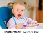 little baby eating | Shutterstock . vector #628971152