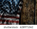 usa flag on a wood surface | Shutterstock . vector #628971362