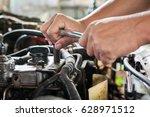 hands of mechanic working in... | Shutterstock . vector #628971512