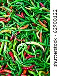 Large collection of mixed chili peppers at Egypt Bazaar (MisirCarsisi) in Istanbul, Turkey - stock photo