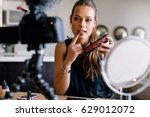 young lady talking on cosmetics ... | Shutterstock . vector #629012072