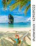 woman relaxing at the beach on... | Shutterstock . vector #629039222