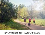 girls running at park with dog  ... | Shutterstock . vector #629054108