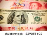 chinese yuan note and u.s.... | Shutterstock . vector #629055602