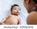 cute asian baby talk to mom... | Shutterstock . vector #629062946