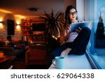 photo of a young woman sitting... | Shutterstock . vector #629064338