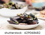 steamed mussels in cheese sauce.... | Shutterstock . vector #629068682