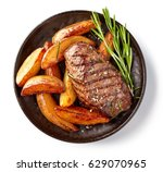 Grilled beef steak and potatoes ...
