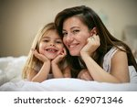 mother with her cute little... | Shutterstock . vector #629071346