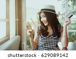 young woman holding credit card ... | Shutterstock . vector #629089142