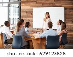 woman giving a presentation at... | Shutterstock . vector #629123828