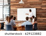 young black man at whiteboard... | Shutterstock . vector #629123882