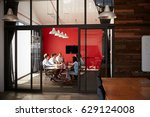 team in a meeting at a creative ...   Shutterstock . vector #629124008