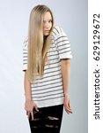 beautiful girl in striped... | Shutterstock . vector #629129672