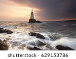 Lighthouse By The Sea Shore At...