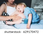 pregnant mother and son are... | Shutterstock . vector #629170472