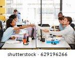 woman passes document across...   Shutterstock . vector #629196266