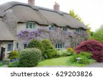 Country Cottage With Wisteria...