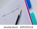 Small photo of What is a mug wump question, hand written on a pad with a ballpoint pen