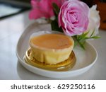 butter cake and pink rose. | Shutterstock . vector #629250116