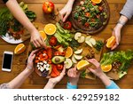 family dinner table. women at... | Shutterstock . vector #629259182