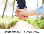 road to life. hands. father's... | Shutterstock . vector #629316962