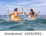 two beautiful sporty surfing... | Shutterstock . vector #629323052