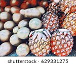 fresh pineapples and avocado on ...   Shutterstock . vector #629331275