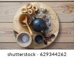 Cups And Teapot On A Wooden...
