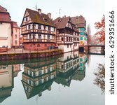 Small photo of Traditional Alsatian half-timbered houses in Petite France with mirror reflections in the morning, Strasbourg, Alsace, France