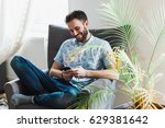 young man using a smartphone...   Shutterstock . vector #629381642