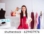 cheerful happy seamstress keeps ... | Shutterstock . vector #629407976