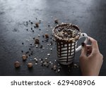 hot chocolate in a mug with nuts | Shutterstock . vector #629408906
