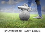 footballer in a green field... | Shutterstock . vector #629412038