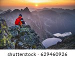 man on the top of mountain with ... | Shutterstock . vector #629460926