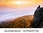 alone man sitting on the top of ... | Shutterstock . vector #629465726