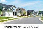 street of suburban homes | Shutterstock . vector #629472962