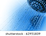 Photograph of a shower head showing drops and streams of water, ideal concept for domestic water usage - stock photo