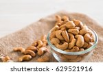 roasted cashew nuts in bowl | Shutterstock . vector #629521916