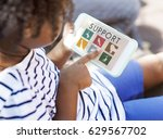 girl playing on the tablet with ... | Shutterstock . vector #629567702