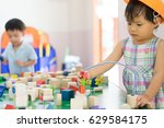 little engineer is trying to... | Shutterstock . vector #629584175